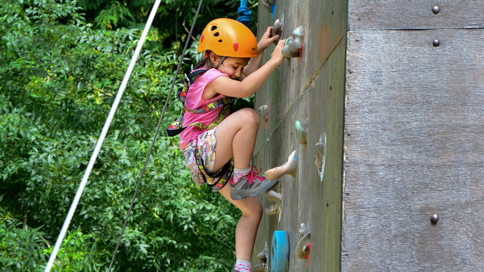 Climbing wall young girl
