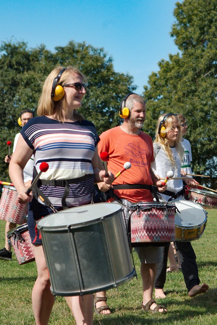 Adults drumming La Grand Ferme